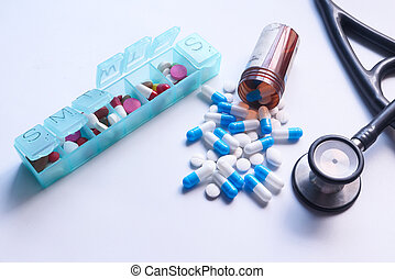 Close up of colorful capsule , pill box and stethoscope on white background