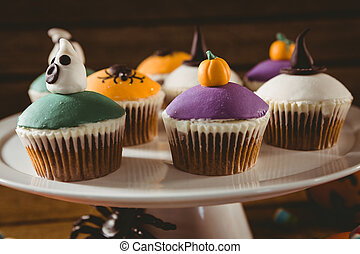 Close up of colorful cup cakes arranged on stand during ...