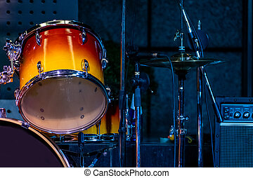 Close-up of colorful drums on stage