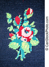 Close-up of colorful flowers knit on blue background