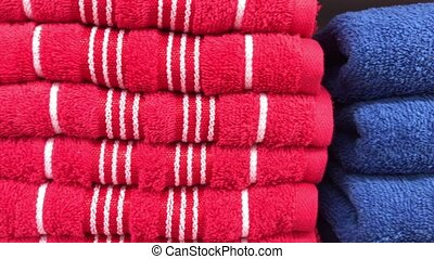 Close up of colorful towels in the store of shopping mall, Bali. Many towels.