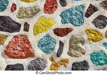 close up of colourful textured cement wall