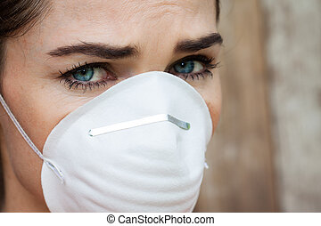 Close-up of concerned woman wearing a face mask
