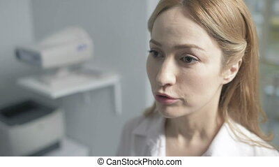 Close up of confident female doctor talking