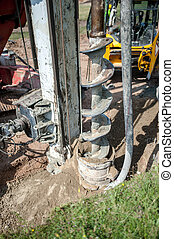 Close up of construction auger, industrial drilling rig...