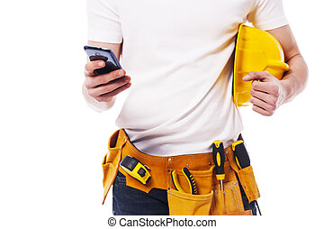 Close-up of construction worker using a mobile phone