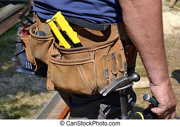 Close up of construction worker with tool belt