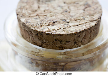Close-up of cork capping a glass container. Horizontal shot...