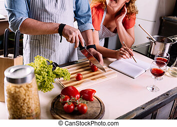 Close up of couple cooking together