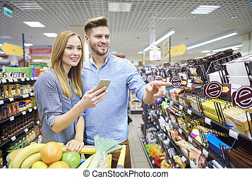 Close up of couple doing the shopping