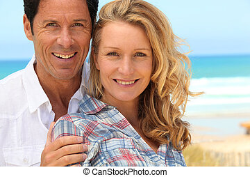 close-up of couple on the beach