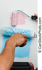 Close-up of Young couple painting new house. Concept of decoration