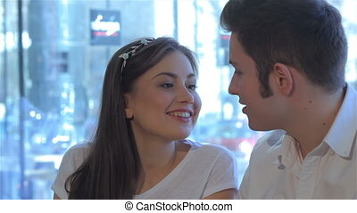 Close up of couple talk to each other at the cafe