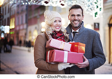 Close up of couple with full of gifts