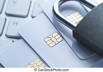 Close up of credit card and padlock.