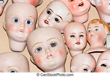 Close up of creepy doll heads