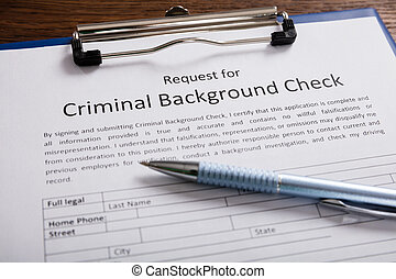 Criminal Background Check Application Form With Pen