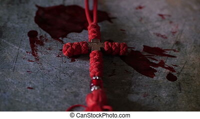 Close up of cross of jesus on bloody background