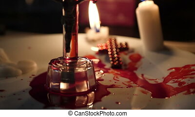 Close up of cross of jesus with blood lit by candle