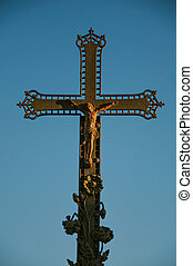 Close-up of cross with blue sky at sunset, in the city center of Chateauneuf-de-Gadagne.