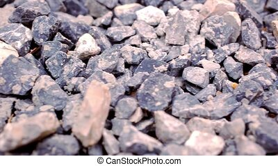 Close-up of crushed gravel. Macro video shift motion...