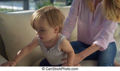 Close up of ctive child sitting on the sofa