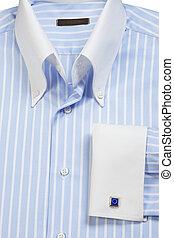 cufflink on blue striped shirt - Close-up of cufflink on...