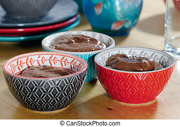 close up of cups with dark chocolate mousse