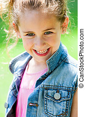 Close up of cute girl with happy smile.