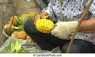 close up of cutting pineapples in the old quarter of hanoi