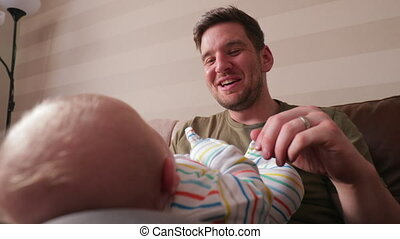 Close- up of Dad Comforting Baby - Dad playing with his...