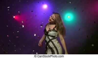 Close-up of dancing girl under glitter confetti. Slow motion