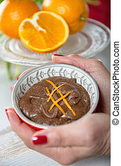close up of dark chocolate mousse with orange