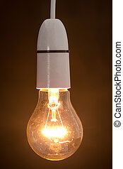 Close up of dazzling light bulb on vertical picture