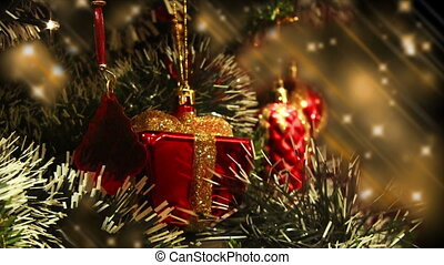 Close up of decorated Christmas tree at night, decorations and lights