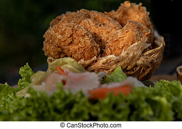 Close-up of Deep-fried shrimp cakes (Tod Mun Goong) and vegetable with chili sauce on wooden background.