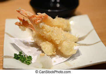 Close up of deep-fried tempura shrimps with soy sauce on ...