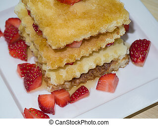 Close up of Delicious pancakes with strawberry.