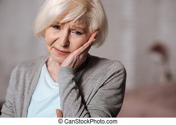 Close up of depressed aged woman
