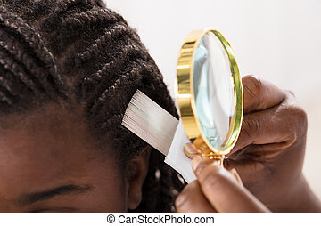 Dermatologist Looking At Patient's Hair - Close-up Of...