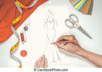 Close-up of designer drawing a fashion sketch