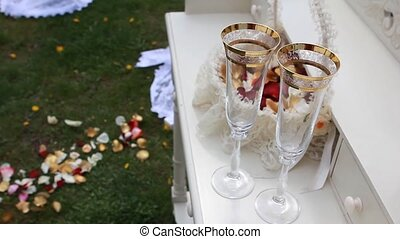 Close up of detail on wedding breakfast dining table setting with champagne glasses.