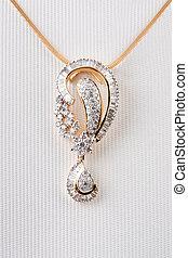Close up of diamond pendant  isolated over white background