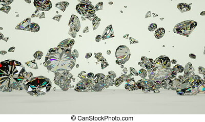 Close up of diamonds falling against white