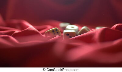 Close up of dice on red satin