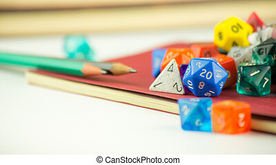 Close up of dice with Pencils on a Notebook