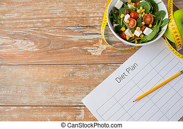 close up of diet plan and food on table - healthy eating, ...