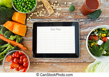 close up of diet plan on tablet pc and vegetables - healthy...