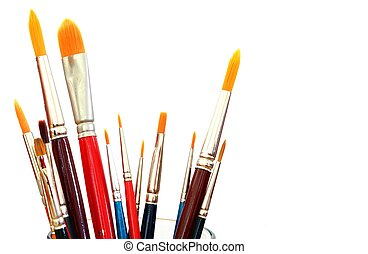 close up of different paint brushes isolated on white background
