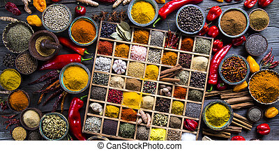 Assorted Spices in a wooden box - Close-up of different...